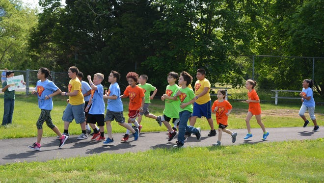 Runners participate in the 38th Durand Run at Durand Elementary School in Vineland.