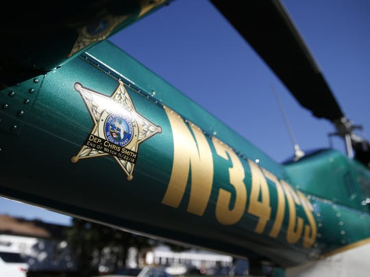 The Leon County Sheriff Office helicopter's identifying tail number was unveiled, memorializing fallen Deputy Chris Smith during a ceremony for fallen officers at the LCSO office on Friday.