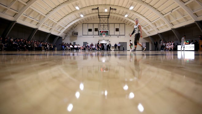 Alfonso, a youth in custody with Rogue Valley Youth Correctional Facility, walks on the court during a dedication of a new gym floor at MacLaren Youth Correctional Facility in Woodburn on Thursday, Feb. 8, 2018. Salem Evangelical Church donated $110,000 to replace the old concrete gym floor at the facility with a new wood floor.