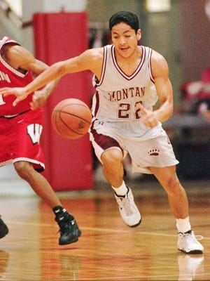 Montana's JR Camel (22) chases a loose ball in front of Wisconsin's Sean Mason (11) during the first quarter of their consolation round game in the Big Island Invitational on Nov. 30, 1997, in Hilo, Hawaii.