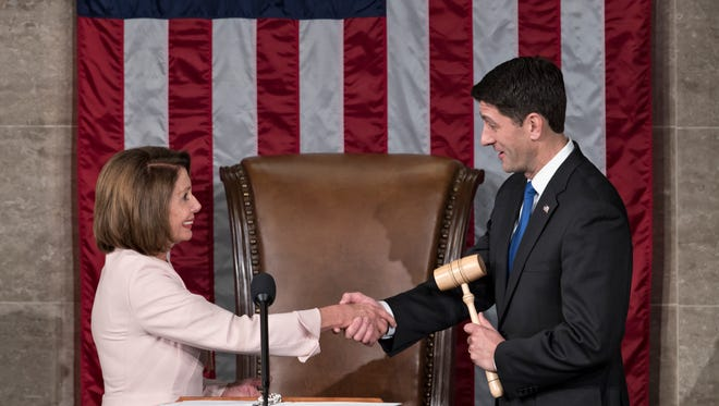 House Speaker Paul Ryan shakes hands with House Minority Leader Nancy Pelosi on Capitol Hill in Washington on Tuesday, Jan. 3, 2017, after he was re-elected to his leadership post as the 115th Congress convened.