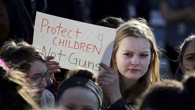 In this Feb. 28, 2018 photo, Somerville High School junior Megan Barnes marches with others during a student walkout at the school in Somerville, Mass. A large-scale, coordinated demonstration is planned for Wednesday, March 14, when organizers have called for a 17-minute school walkout nationwide to protest gun violence. (Craig F. Walker/The Boston Globe via AP)