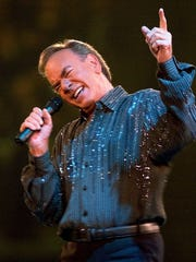 *Singer Neil Diamond performs in Denver, on Dec. 31,