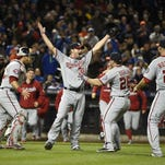 Washington Nationals starting pitcher Max Scherzer, second from left, celebrates his no hitter against the New York Mets with teammates, catcher Wilson Ramos (40), Dan Uggla (26), and Clint Robinson (25) in the second baseball game of a doubleheader, Saturday, Oct. 3, 2015, in New York. The Nationals won 2-0. (AP Photo/Kathy Kmonicek)