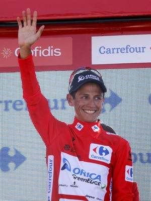 Orica GreenEdge's Colombian cyclist Esteban Chaves Rubio celebrates on the podium his overall leader's red jersey after the fourth stage of the 2015 Vuelta Espana on Aug. 27, 2015.