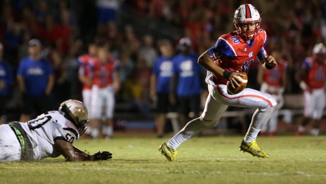 Quarterback Griffin Alstott (10), of Northside Christian, escapes Dorian Williams of Admiral Farragut during the second quarter of the game against Admiral Farragut on Thursday October 29, 2015 at Northside Christian in St. Petersburg. Alstott, the son of Purdue great Mike Alstott, committed to the Boilermakers after visiting earlier this week.