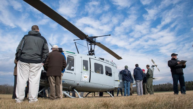 The Office of Naval Research Innovative Naval Prototype program called the Autonomous Aerial Cargo Utility System (AACUS) installed one on a Bell UH-1H helicopter shown at an airfield in Bealeton, Va.