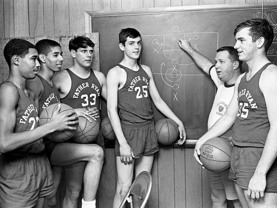 Father Ryan head coach Bill Derrick, second from right,