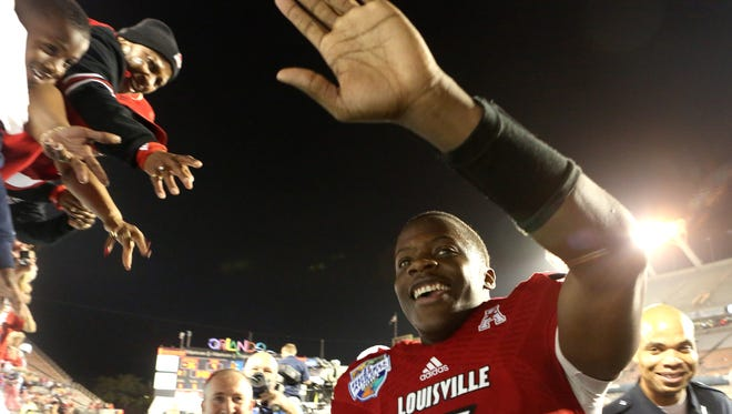 Louisville quarterback and game MVP Teddy Bridgewater meets with the crowd after the Russell Athletic Bowl at the Citrus Bowl Stadium in Orlando, Fla. U of L defeated Miami 36-9. Dec. 28, 2013.