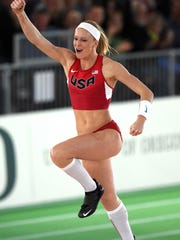 Mar 17, 2016; Portland, OR, USA; Sandi Morris (USA) celebrates after a clearance in the womens pole vault during the 2016 IAAF World Championships in Athletics at Oregon Convention Center. Morris finished second at 15-11 (4.85m). Mandatory Credit: Kirby Lee-USA TODAY Sports