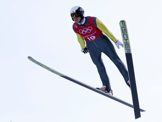 Hannu Manninen, of Finland, soars through the air during training for the men's nordic combined competition at the 2018 Winter Olympics in Pyeongchang, South Korea, Tuesday, Feb. 13, 2018. Finland's Nordic combined legend Manninen, took time out from his job as an airline pilot for Finnair to make one final comeback at his sixth Winter Olympic Games. (AP Photo/Kirsty Wigglesworth)