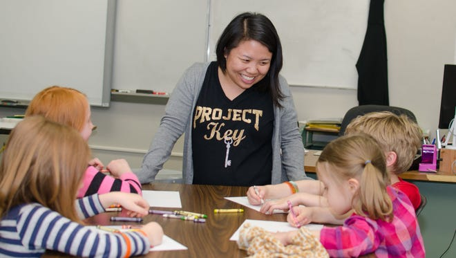 Panya Yang, school counselor at Merrill Elementary School, discusses a book about feelings with students after they read it together. The activity is one of many that staff members are using to support students' mental health in schools.