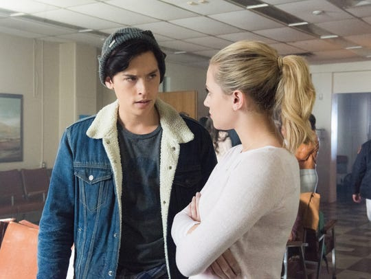 Jughead (Cole Sprouse) is dating Betty (Lili Reinhart)