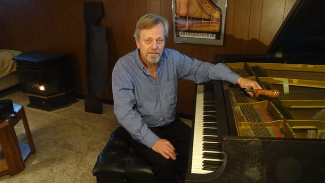 David Chadwick recently moved to Coshocton from Las Vegas, Nevada, where he had tuned pianos for 21 years. Now going into business locally, Chadwick is pictured here with his 1923 Steinway Model M baby grand piano.