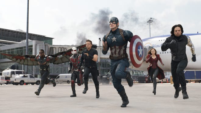 "Anthony Mackie (from left),  Paul Rudd, Jeremy Renner, Chris Evans, Elizabeth Olsen and Sebastian Stan hit the ground running in a scene from ""Captain America: Civil War."""
