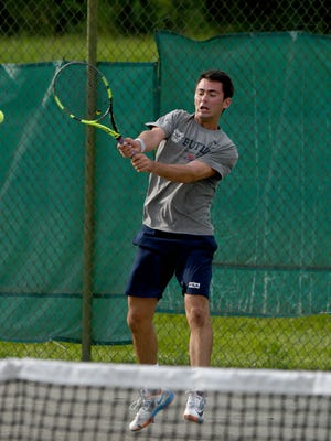 Mason Dragos smacks a backhand return in winning his fifth straight men's singles title and sixth in seven years in the 84th News Journal/Richland Bank/matchmatetennis.com Tennis Tournament.