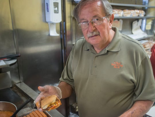Theo Katechis, owner of ChrisÕ Hot Dogs, is one of