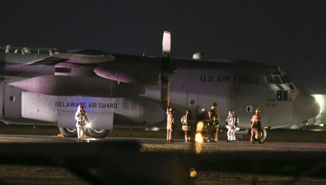 Emergency crews investigate after a Delaware Air National Guard C-130 made an emergency landing Wednesday night.