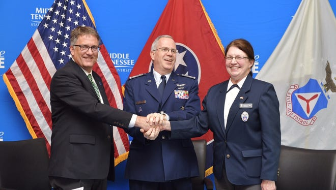 From left, MTSU Interim Provost Mark Byrnes shakes hands with Col. Barry Melton, commander of the Civil Air Patrol's Southeast Region, and Col. Arlinda Bailey, commander of CAP's 1,000-member Tennessee Wing, after signing a three-year extension of the pact that links CAP with MTSU's Department of Aerospace in the College of Basic and Applied Sciences. The signing ceremony was held Friday, March 17, in the MTSU Student Union Building.