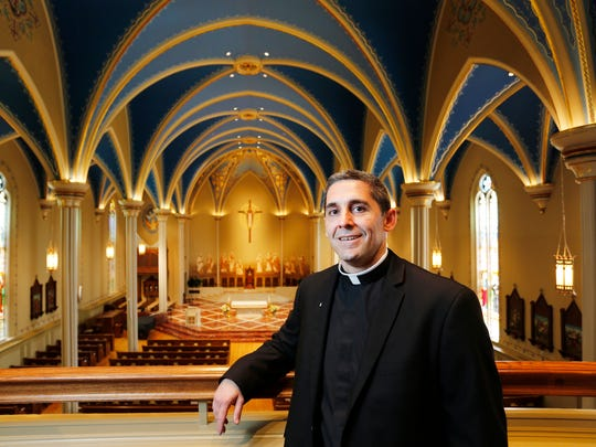 Fr. Jeff Martin stands inside the sanctuary at St. Mary Cathedral Friday, August 12, 2016, in Lafayette. The church is celebrating its 150th anniversary at its lColumbia Street Hill location.