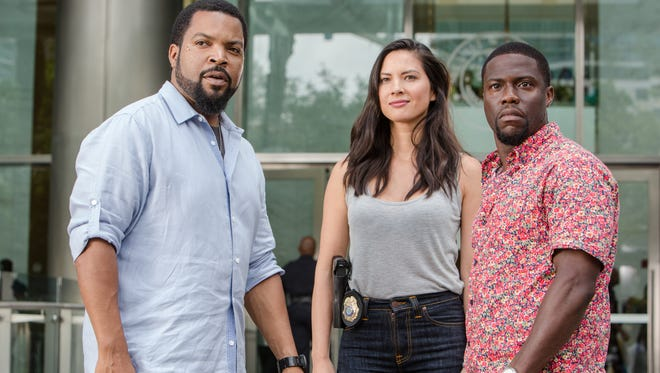Ice Cube, left, Olivia Munn and Kevin Hart in cop comedy 'Ride Along 2.'