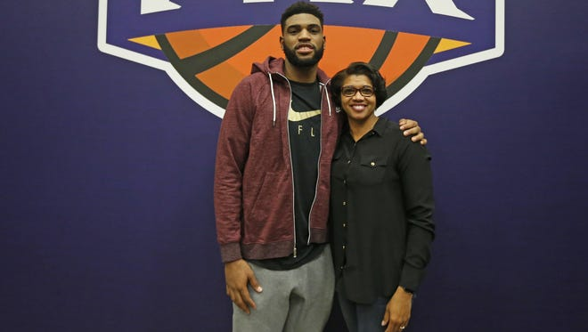 Phoenix police chief Jeri Williams and her son, the Suns' Alan Williams, pose for a photo after a game on November 12, 2016 in Phoenix, Ariz.