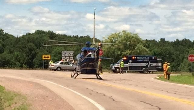 A Spencer man died Tuesday after a car hit his motorcycle at the intersection of Highways 73 and 95 south of Neillsville in Clark County.