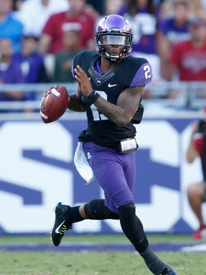TCU Horned Frogs quarterback Trevone Boykin (2) scrambles in the fourth quarter against the Oklahoma Sooners at Amon G. Carter Stadium. The Horned frogs beat the Sooners 37-33.