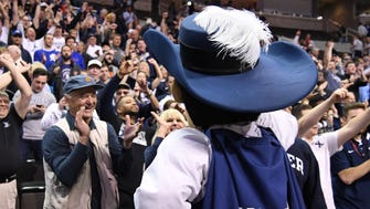 Bill Murray cheers the Musketeers.