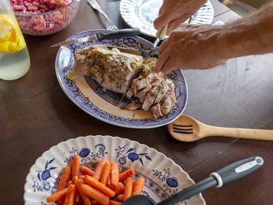 "Bob Orvis of Glendale prepared a dinner of a pork tenderloin roast, braised cabbage and boiled carrots. ""I think it's fun to cook, and you don't have to go out to eat,"" Orvis said."