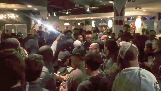 Bowling event involving Michigan and South Carolina players gets heated with authorities called in to separate those quarreling.