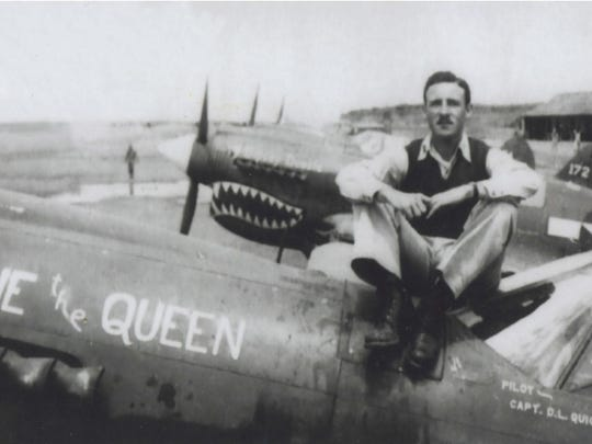 """Donald Quigley poses in 1943 with his P-40 Warhawk fighter nicknamed """"Rene the Queen"""" in Hengyang, China. Quigley earned a title as an ace for downing five Japanese warplanes before he was shot down Aug. 10, 1944."""