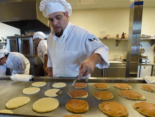 Chef David Gonzales turns over pancakes at the Original Pancake House Tuesday July 15, 2014.