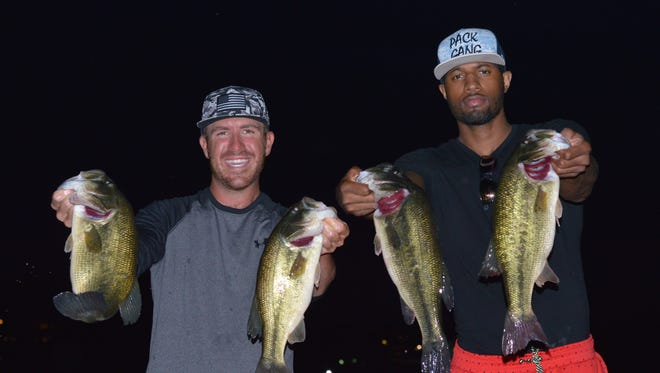 Jacob Wheeler and Paul George show off their catch during a fishing tournament at Geist Reservoir on May 5, 2015.