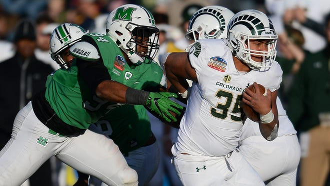 CSU running back Izzy Matthews, shown running past Marshall defender Channing Hames in the 2017 New Mexico Bowl, built his own computer in the offseason. He uses it primarily to play video games, he said.