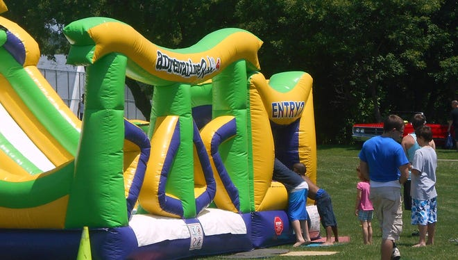 Children enjoy Bobby K inflatables during last year's Family Day, organized by the Town of Horseheads Youth Bureau.