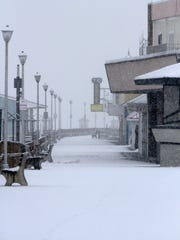 An empty and snow-covered Pt. Pleasant Beach Boardwalk .