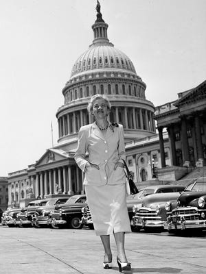 Senator Margaret Chase Smith (R-Maine) walks in the capitol plaza with the Capitol in the background, June 14, 1950, in Washington D.C.