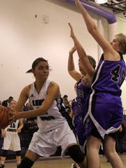 Lauryn Yuzos tries to get a pass off while being defended by two Gateway Christian players. Mescalero defeated Gateway Christian 68-13 Thursday night.