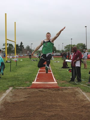 Jacob Back, of Harrison High School, competes in the long jump at the 2017 Southwest Ohio Conference track and field meet at Ross High School.