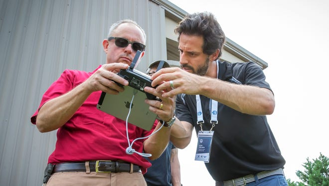 Middle Tennessee-based UAV Coach instructor Alan Perlman, right, gives instructions to Brian Roberston during drone flying class.