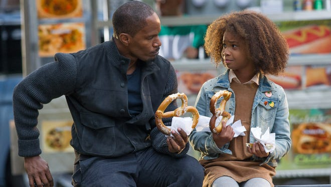 """Jamie Foxx, left, as Will Stacks and Quvenzhané Wallis as Annie in a scene from  """"Annie."""""""