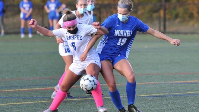 Norwell's Anna Kirchner, right, tangles with Mashpee's  Brooke Johnston for the ball during girls soccer at Norwell High School, Friday, Oct. 9, 2020. Tom Gorman/For The Patriot Ledger
