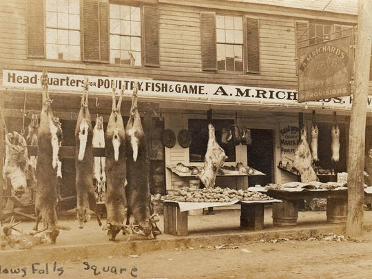 Historic photo shows deer hanging utside the A.M. Richards Market in Bellows Falls.