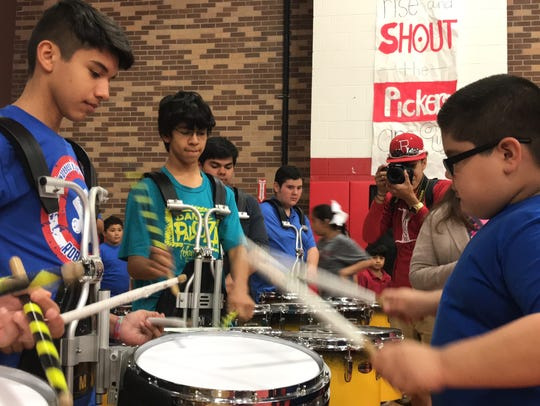 Andrew Guerrero, 9, plays with drummers in the Robstown