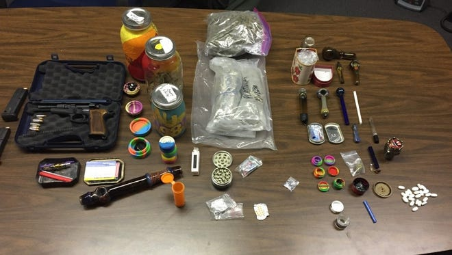 Major Crimes Unit detectives reported they seized more than 2 1/2 pounds of high-grade marijuana packaged for sale, one gram of methamphetamine, several ounces of concentrated THC, prescription drugs, thirteen individual doses of LSD, a 9 mm semi-automatic handgun, drug paraphernalia and packaging materials Thursday in Lancaster.