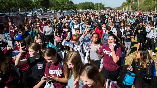 Thousands of West Glade Middle School and Marjory Stoneman Douglas High School students walk out of school and make their way to Pine Trails Park during the National School Walkout at Marjory Stoneman Douglas High School in Parkland, Fla., on Wednesday, March 14, 2018.