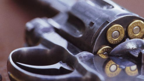 Stock image of a loaded revolver. Type of gun shown is for illustrative purposes only.