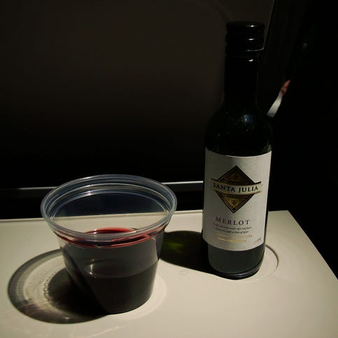 A glass of wine on the plane is tempting. Here's why you should dodge the urge