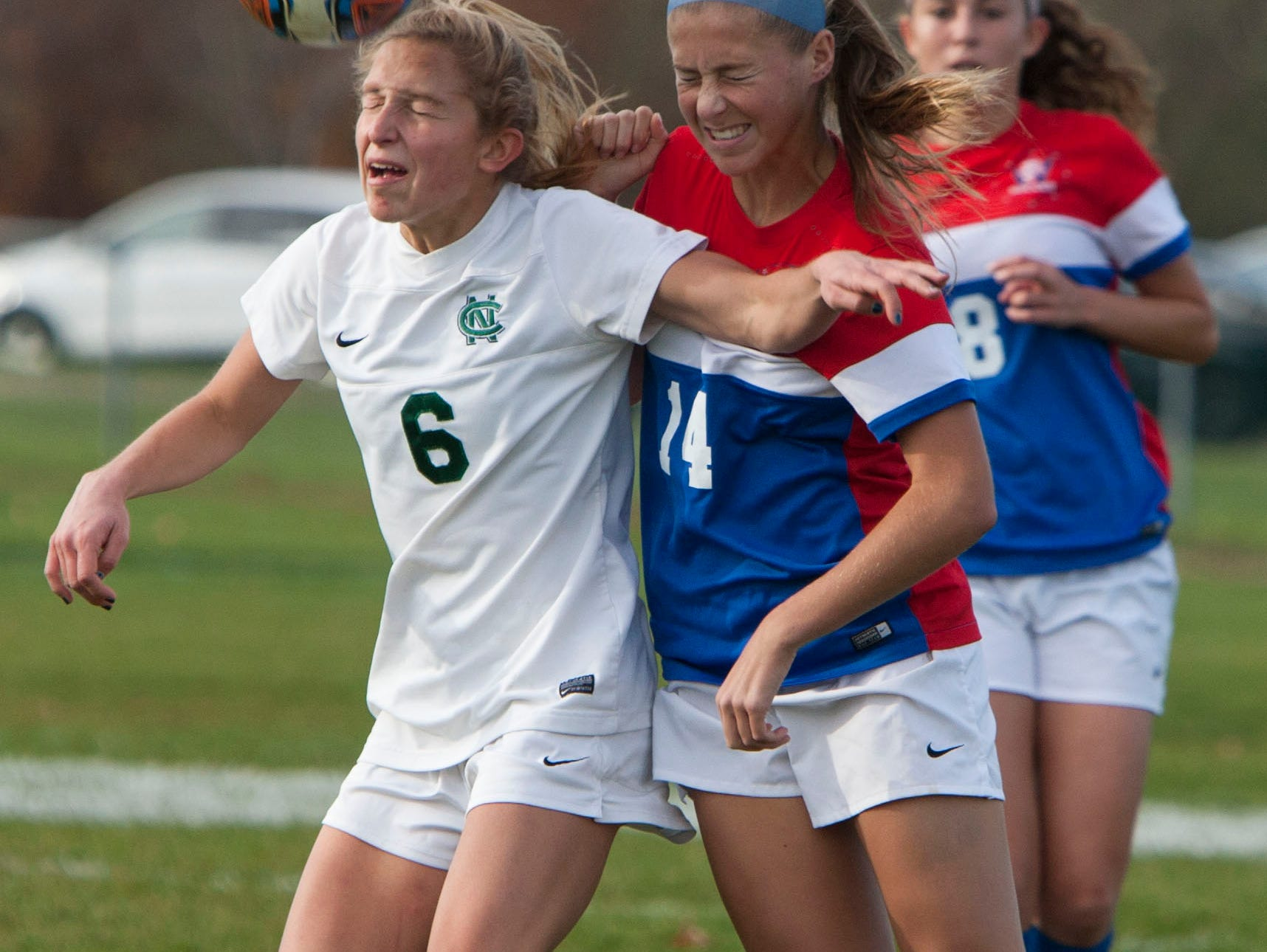 Girls soccer Wall at Colts Neck. CN #6 Allison Russo heads the ball in front of Wall #14 Hailee Reinhardt—November 9, 2015-Colts Neck, NJ.-Staff photographer/Bob Bielk/Asbury Park Press